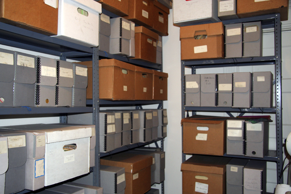 Metal shelves containing archival and file boxes.