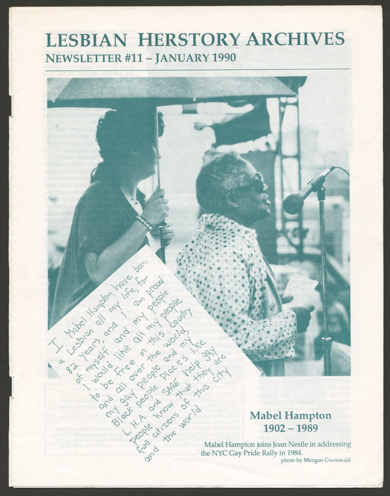 """The front of an LHA newsletter dated January 1990. There is a photograph of Mabel Hampton at a microphone with a caption that reads """"Mabel Hampton joins Joan Nestle in addressing the NYC Gay Pride Rally in 1984."""""""