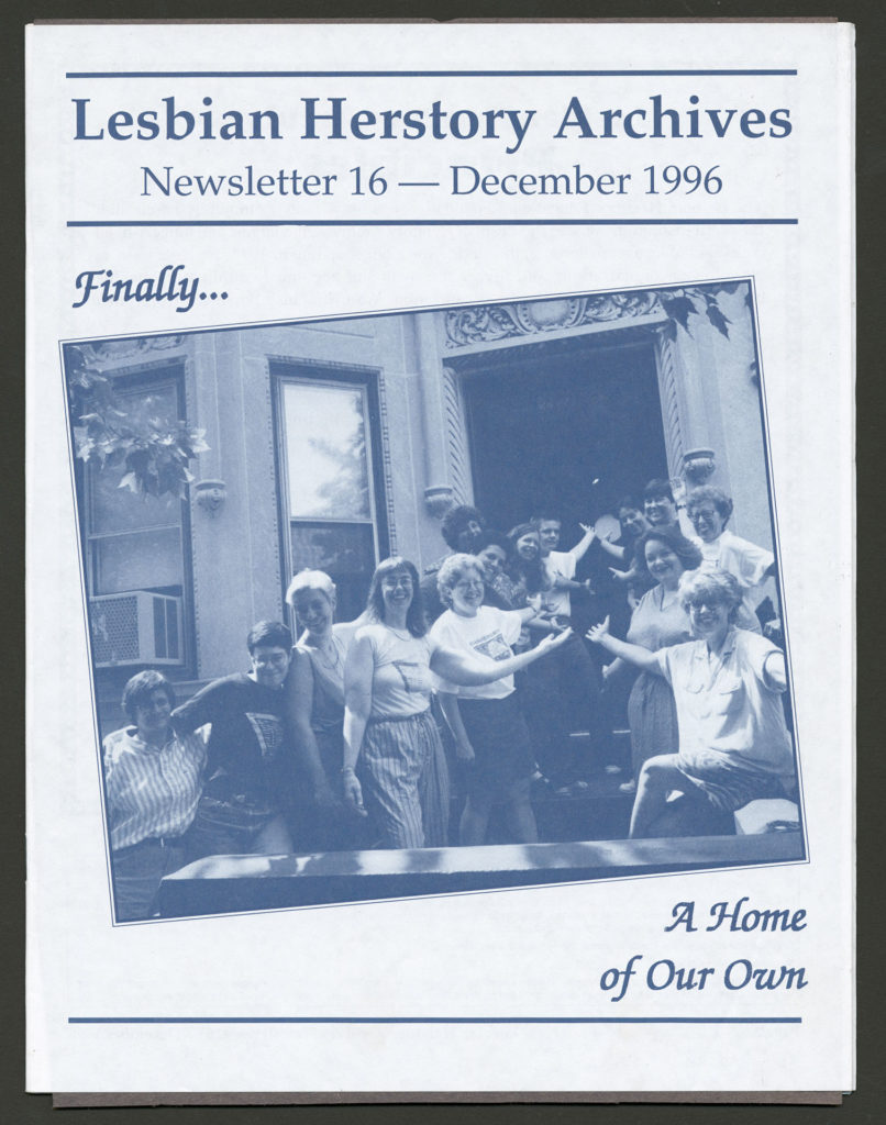 """The front of a newsletter dated December 1996. The photo on the cover is of a group of smiling Lesbians gesturing toward the door of the LHA building. The caption reads """"Finally...A Home of Our Own."""""""