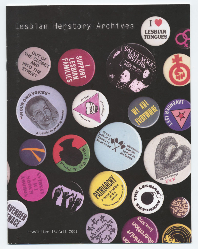 The front of an LHA newsletter dated fall 2001. The photograph is of a variety of Lesbian and Feminist themed pin-on buttons.