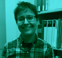 Headshot of a lesbian with a background of books on a shelf.