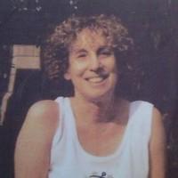 Headshot of a smiling lesbian.