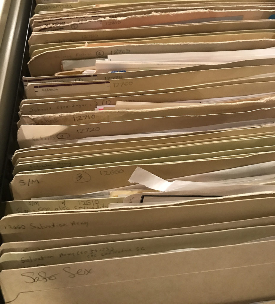 An open file drawer full of folders.