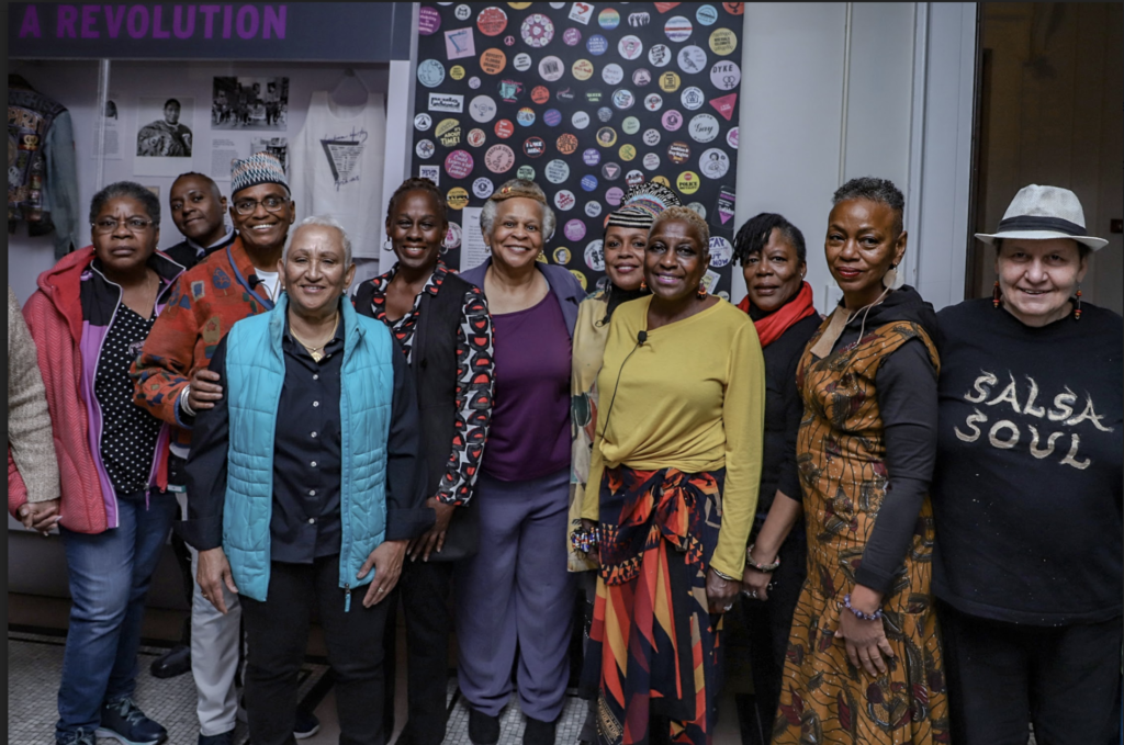 Original Salsa Soul Sisters members stand affront the NYHS exhibition
